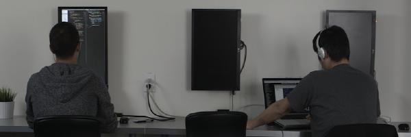 students-sitting-at-computer-coding