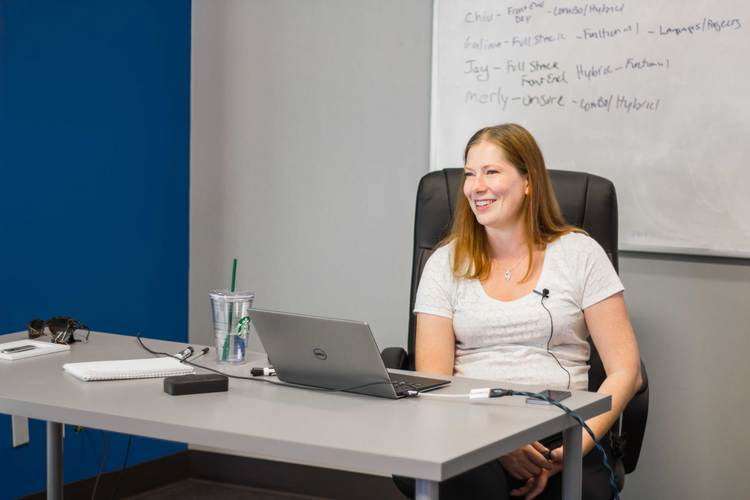coding-dojo-instructor-sitting-at-desk